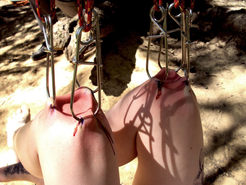 Suspended And Balanced On Their Knees